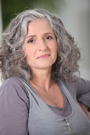 foreclosure: Portrait of relaxed gray-haired woman