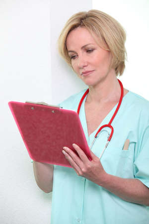 A female doctor taking notes on a clipboard. Stock Photo - 10855244