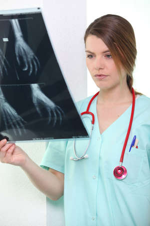 Nurse looking at X-ray Stock Photo - 10855286