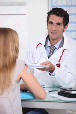 handing: Male doctor with young patient