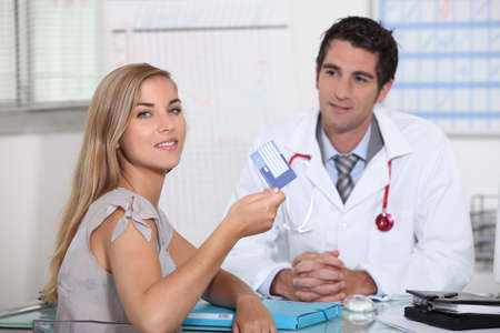 healthy person: Young person showing European health card Stock Photo