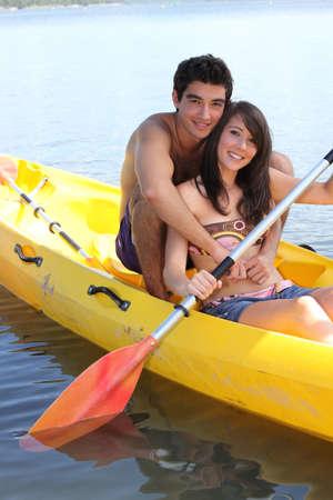 paddle: Young couple kayaking Stock Photo