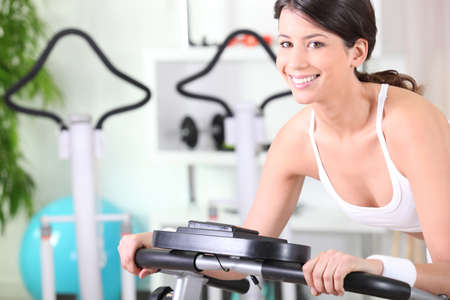 verve: young brunette doing fitness in a fitness center