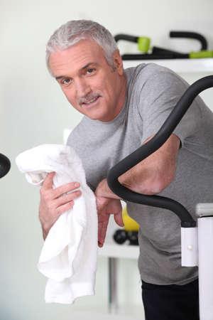 exercitation: Smiling mature man in gym