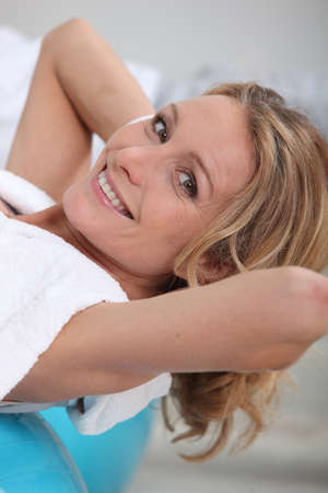 back rub: mature woman in a spa Stock Photo