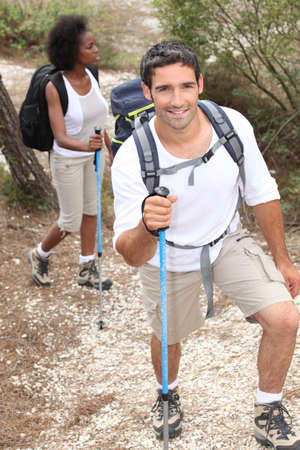 trekking pole: Couple hiking Stock Photo