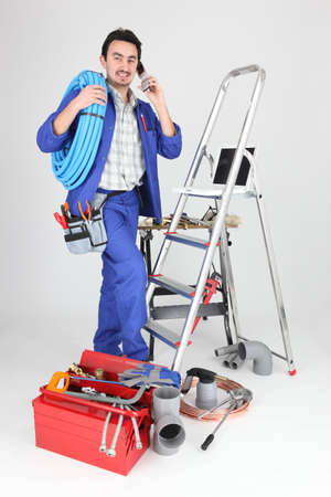 flexi: Plumber with materials, toolbox and cellphone