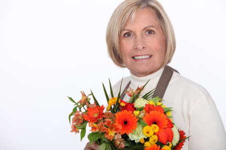 50 to 55 years: Florist holding a bouquet of flowers