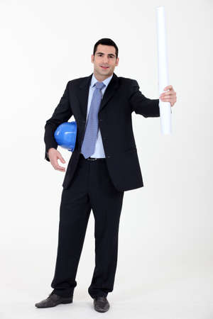 foremaster: businessman holding a helmet and a blueprint