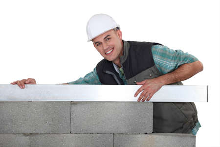 cement solution: A mason building a wall.