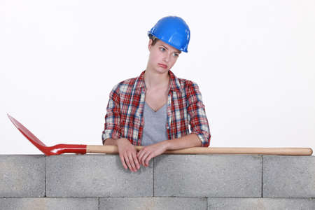 Sad female construction worker photo