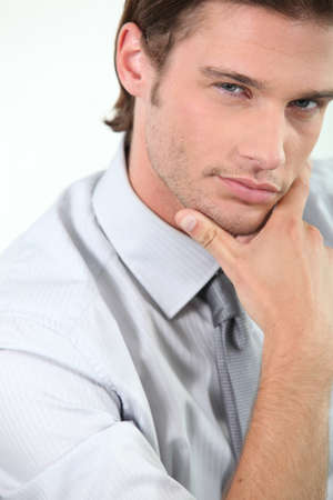 Young businessman holding chin photo