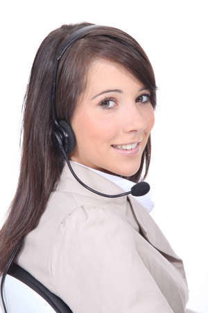 Studio shot of young woman with a headset photo