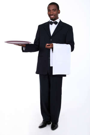 tray: Butler with an empty tray Stock Photo
