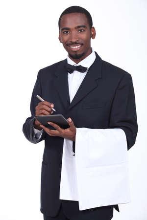 'take: Smart waiter taking order Stock Photo
