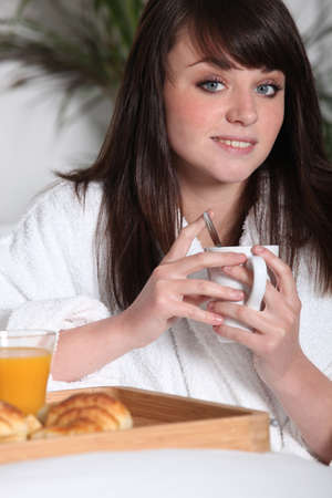young woman having breakfast Stock Photo - 11049551