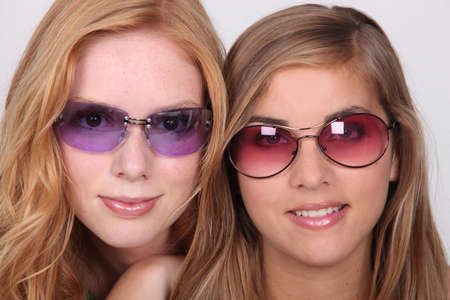 Girls wearing sun-glasses photo