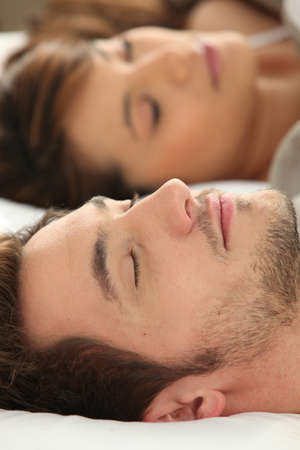 Man and woman sleeping deeply photo