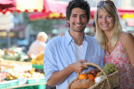 produce sections: Couple shopping at local market
