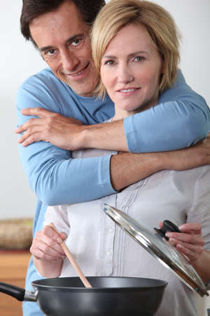 45 49 years: Couple cooking in the kitchen Stock Photo