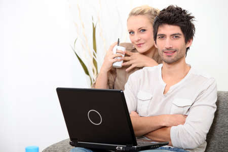 Couple relaxing at home on a Sunday morning Stock Photo - 11049543