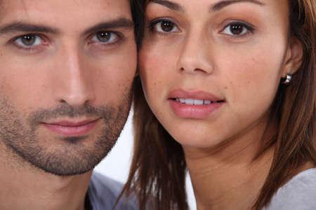 Close-up portrait of a couple photo