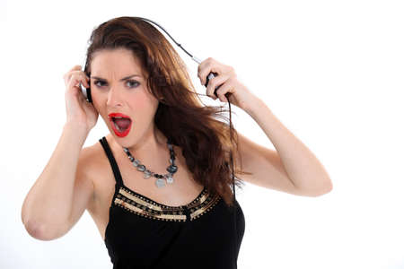 Woman listening to music with headphones. photo
