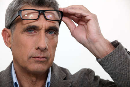 one mature man only: Man raising his glasses Stock Photo
