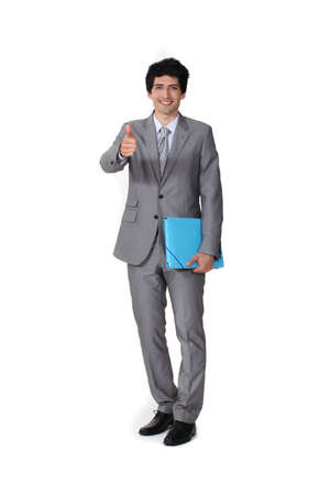 Portrait of a businessman giving the thumb Stock Photo - 11049378