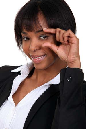 African American woman gesturing smallness. Stock Photo - 11049519