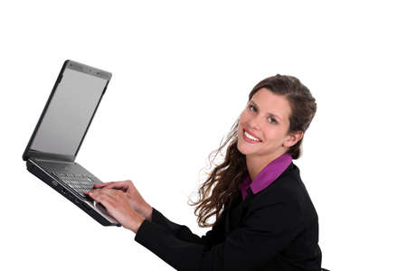 midair: Woman typing on a laptop in mid-air
