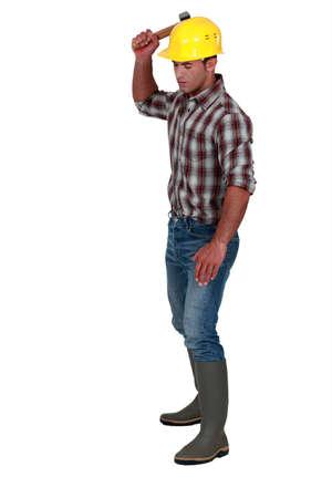 Tradesman using a mallet Stock Photo - 11049386