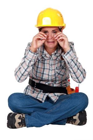 A sobbing tradeswoman Stock Photo - 11048493