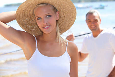 sea fishing: Couple at a lake in summer Stock Photo