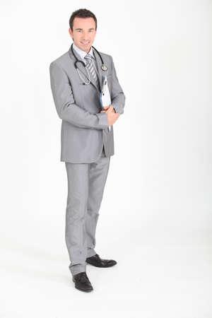 licensed: Doctor stood holding clipboard