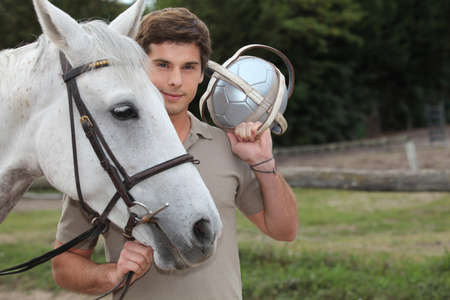 portrait of a young man with horse photo
