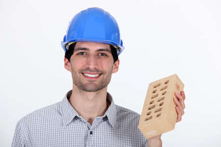 builder showing a brick photo