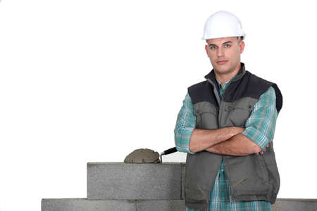 blue collar: Tradesman standing by his work Stock Photo