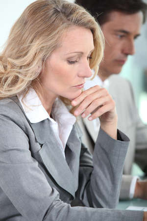 Woman thinking in meeting Stock Photo - 11717621