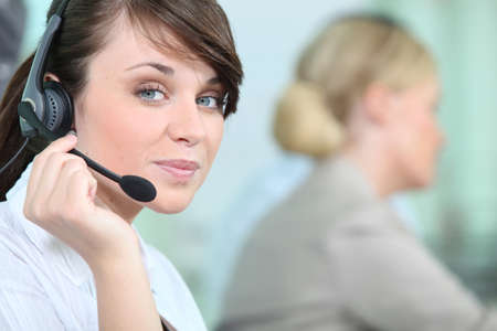 helpline: portrait of a woman with headset Stock Photo