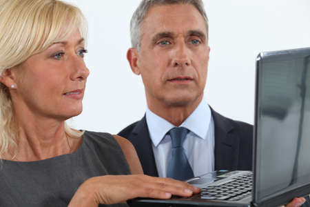 45 55 years: Business professionals looking at a website Stock Photo