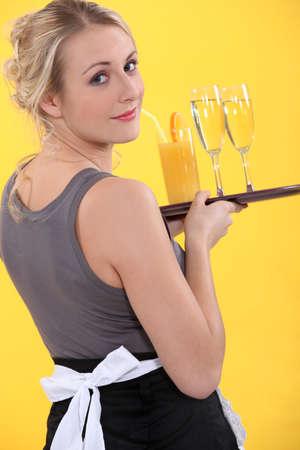 steward: A cocktail waitress Stock Photo