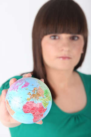 young woman taking a little globe in her hand Stock Photo - 11066903