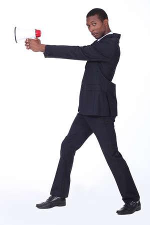 Man holding loud speaker Stock Photo - 11050696