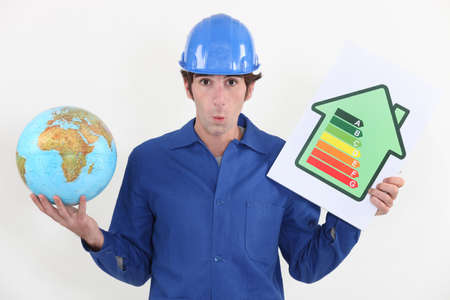 Man holding energy rating poster and globe photo