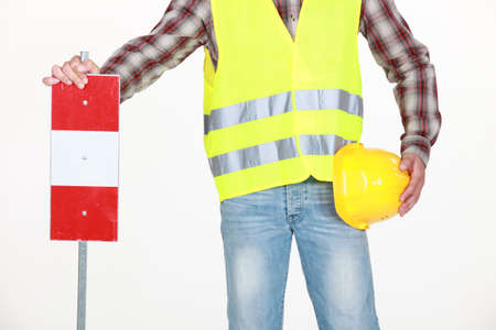 intercept: Road worker with sign Stock Photo