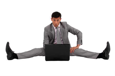 apart: Man sitting on the floor with his laptop