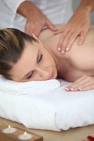 Woman enjoying a massage Stock Photo - 11066943
