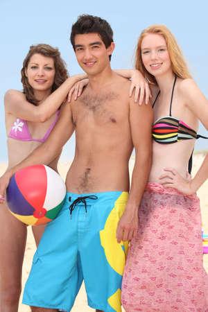 Teenagers on a beach photo