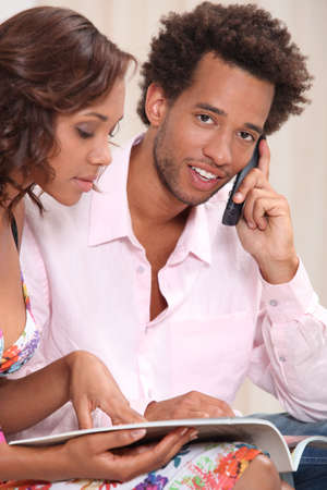 Couple ordering goods over the telephone Stock Photo - 11143718